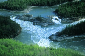 Water links us to our neighbour in a way more profound and complex than any other. – John Thorson, Judge and scholar Whitemud Falls on the Nelson River in northern Manitoba.