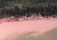Not all hydro waters are clean and sparkling. Here, a plume of murky water can be seen along this eroding and debris-strewn shoreline in the hydro-affected Nelson River system of northern Manitoba.